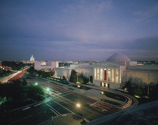 Elevated view of the National Gallery of Art with the U.S. Capitol from northwest at night, c. 1990. ©Dennis Brack/Black Star.  National Gallery of Art, Washington, D.C., Gallery Archives
